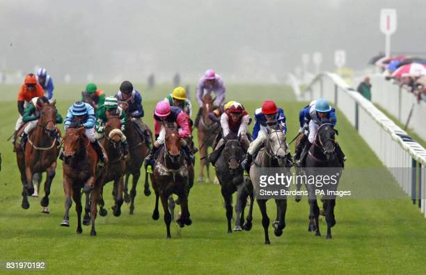 Partners in Jazz ridden by Ryan moore leads out the field to win the totesport Victoria Cup at Ascot racecourse