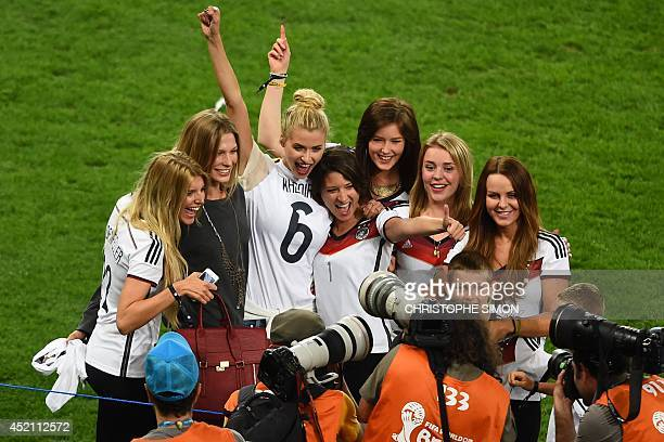 Partners of German squad members pose after Germany won the 2014 FIFA World Cup final football match between Germany and Argentina at the Maracana...