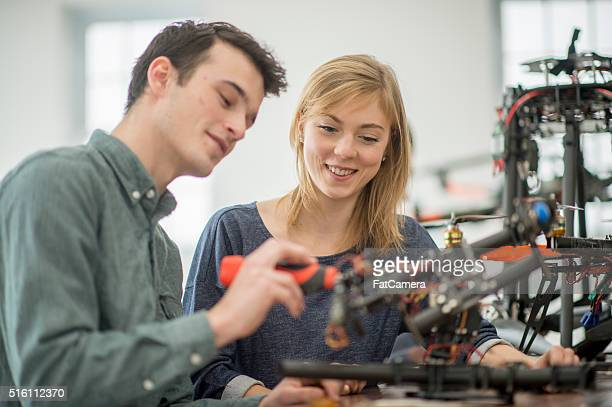 Partners Working on a Drone in the Lab