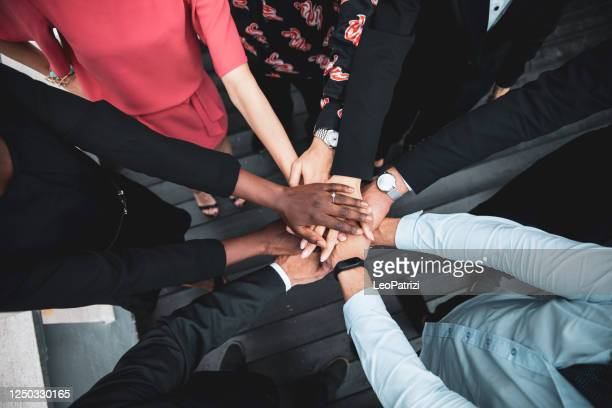 partnership and teamwork is the key to the success - anti racism stock pictures, royalty-free photos & images