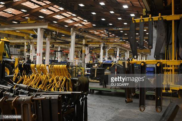 Parts for JCB diggers loaders and other heavy machinery are pictured inside of JCB's headquarters in Rocester central England on January 18 2019