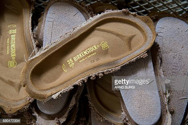 Parts for the production of Birkenstock shoes are seen at the Alsa GmbH company in Goerlitz eastern Germanyon May 10 2016 / AFP / dpa / Arno Burgi /...