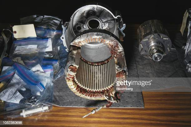 Parts from the motor of a disassembled Tesla Inc Model 3 electric vehicle sit inside the Munro Associates Inc warehouse in Auburn Hills Michigan US...