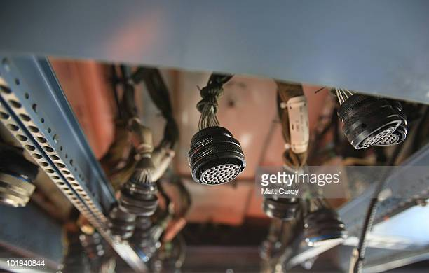 Parts in the flight deck of an aircraft at Air Salvage International are seen hanging as it awaits being dismantled on June 9, 2010 in Kemble,...