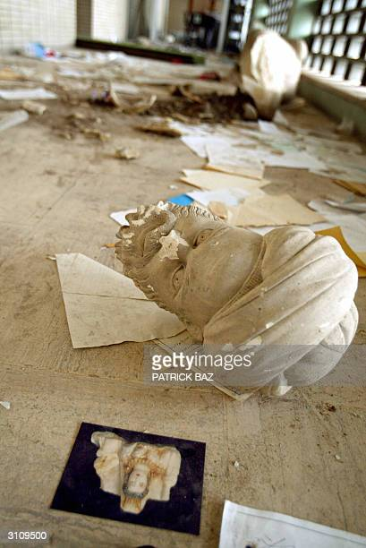 Parts of a beheaded sculpture lies among rubble after a mob of looters ransacked and looted Iraq's largest archeological museum in Baghdad 13 April...