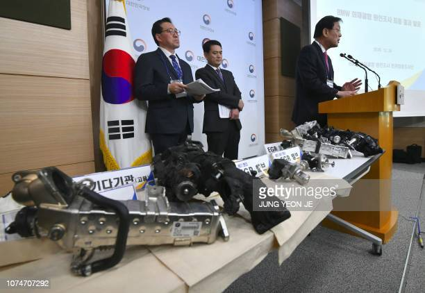 Parts of a burnt BMW car are displayed on a table during a press conference announcing the result of a fivemonth joint probe into BMW car engine...