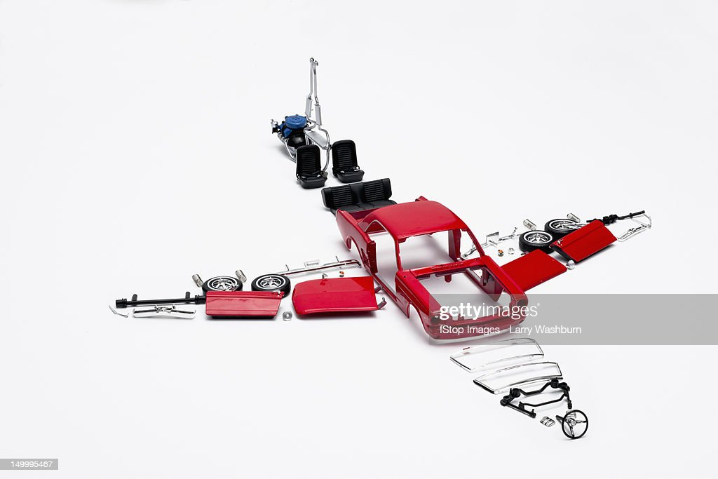 Parts of a model car arranged in the form of an airplane : Stock Photo