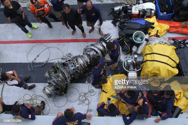 TOPSHOT Parts of an engine of the illfated Lion Air flight JT 610 are recovered from the sea during search operations in the Java Sea north of...