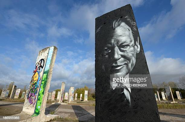 Parts of former Berlin Wall one featuring Willy Brandt chancellor of the Federal Republic of Germany from 1969 to 1974 are displayed for sale on...
