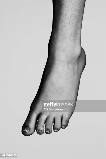 parts of nude body of woman on grey background - human body part ストックフォトと画像
