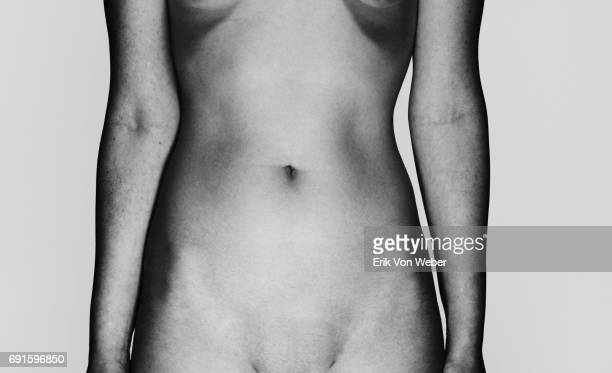 parts of nude body of woman on grey background