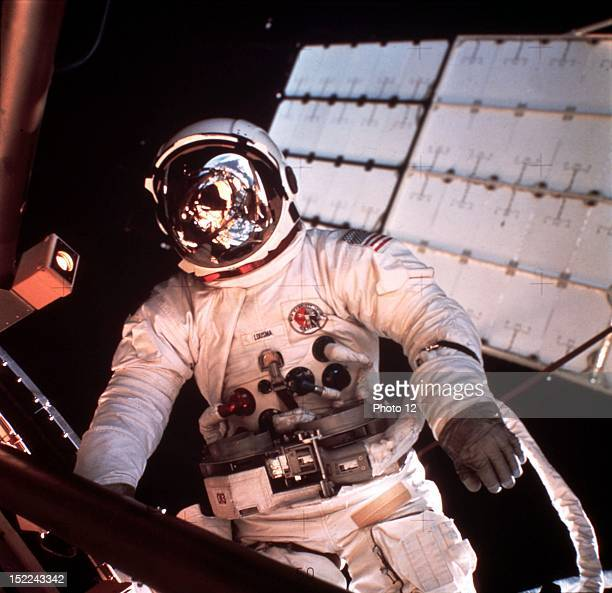 Parts of Skylab and Earth are reflected in the helmet visor of US astronaut Jack Lousma in EVA during Skylab II mission