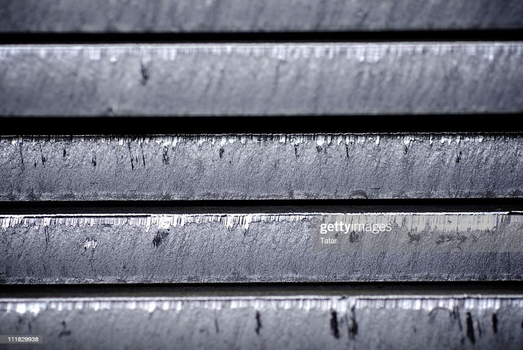 Parts of some metal object with some scratches : Stock Photo