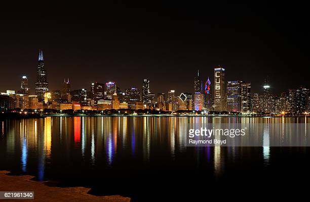 Parts of the Chicago Skyline lights up blue and red to celebrate the Chicago Cubs' world series win against the Cleveland Indians in Chicago Illinois...