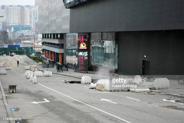 Parts of the road and pavement collapsed outside a shopping mall due to a burst heating pipeline main in Kyiv, capital of Ukraine. - PHOTOGRAPH BY...