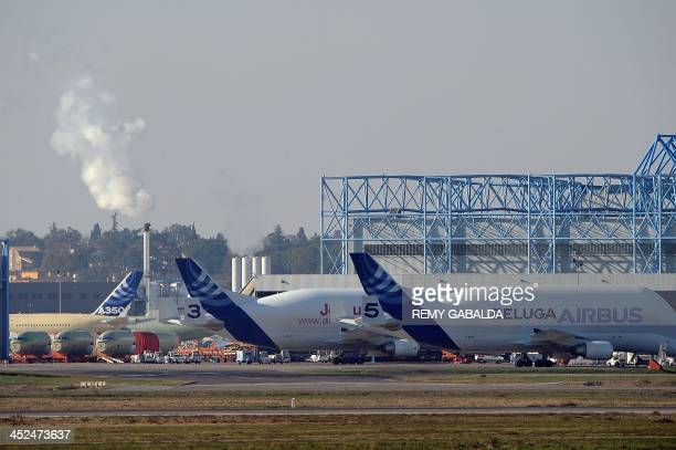 Parts of three Airbus A320 a A350 and A330 as well as a Beluga are seen under construction on November 29 2013 in front of the A330 an A320 European...
