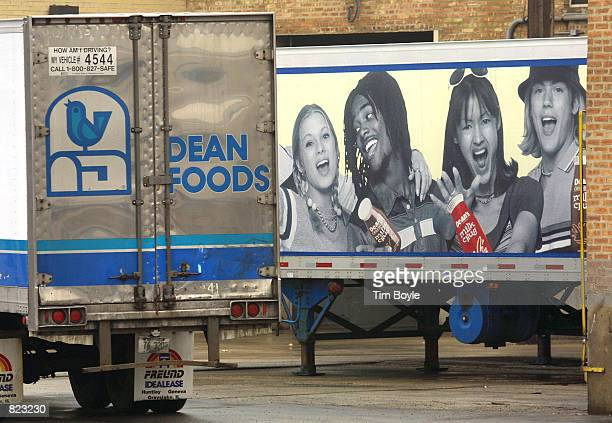 Parts of two Dean Foods trucktrailers are parked April 6 2001 behind their Franklin Park IL corporate headquarters In a giant milk merger pairing the...