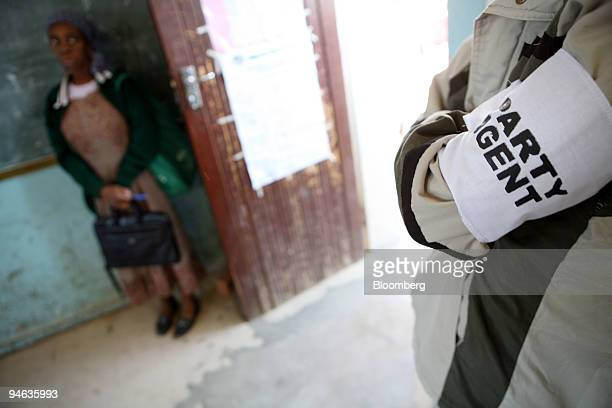 Party agent observes the voting proceedings at a voting station in Maseru, Lesotho, on Saturday, Feb. 17, 2007. Voters in the southern African...