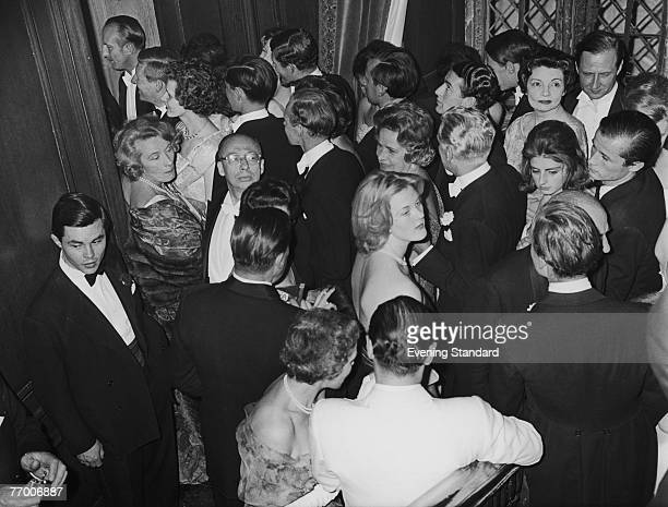 A party at Sutton Place the Surrey home of American oil tycoon J Paul Getty 1st July 1960 The guests queue up to enter the dining room