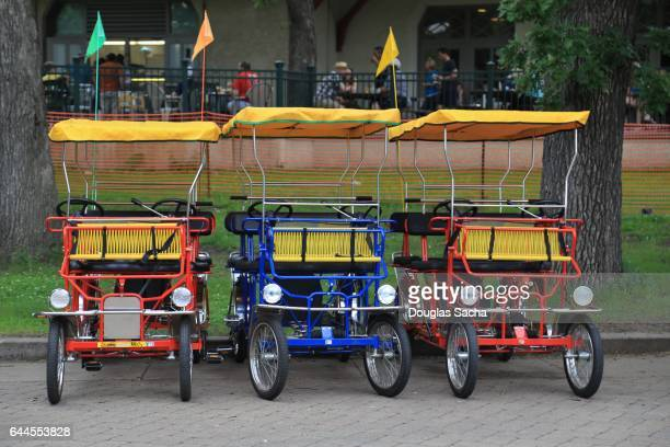 Party Bicycles for tourist are parked along the paved trail