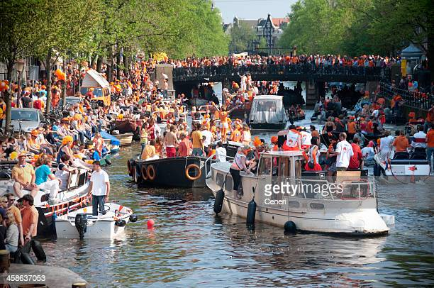 party boats on queen's day (amsterdam, netherlands) - king's day netherlands stock pictures, royalty-free photos & images
