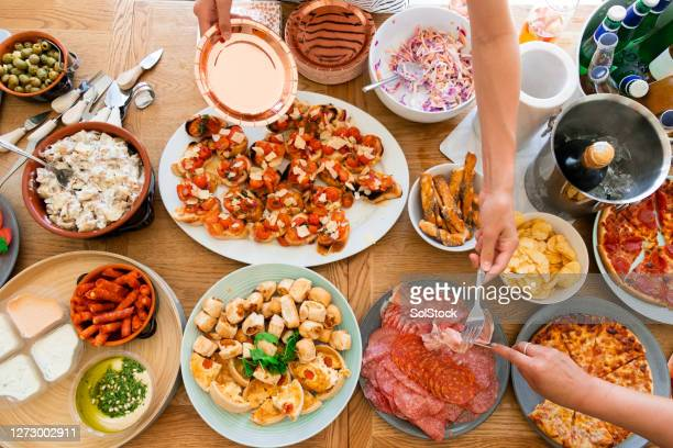 party buffet - spread stock pictures, royalty-free photos & images