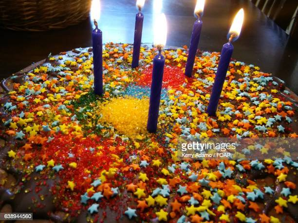 party cake with candles - adamo photos et images de collection