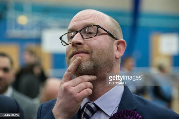 UKIP party candidate Paul Nuttall listens as the Labour party's candidate Gareth Snell delivers his victory speech in the Fenton Manor Sports Complex...