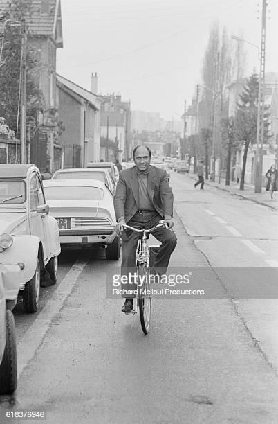 Party candidate Serge Dassault rides a bicycle through the streets of Corbeil. Dassault is the son of the aircraft manufacturer Marcel Dassault.