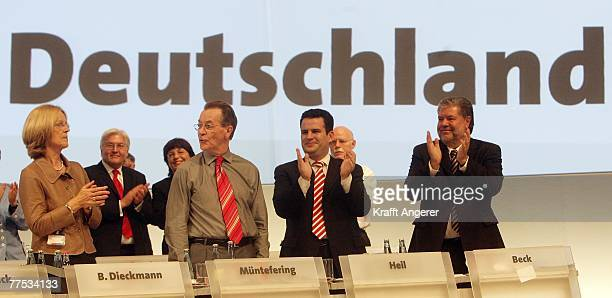 Party Chairman Kurt Beck and Hubertus Heil general secretary of the SPD and Baerbel Dieckmann applaud German Vice Chancellor and Minister of Work and...