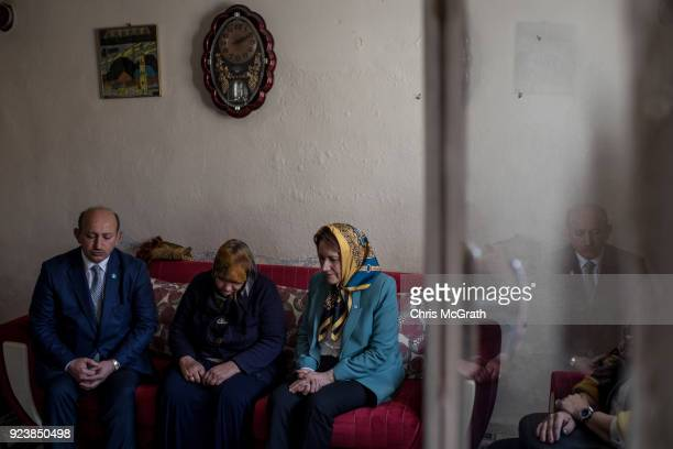 Party Chairman Meral Aksener prays with family members who had recently lost a family member during Operation Olive Branch on February 24 2018 in...