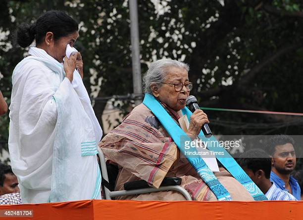 TMC party chief and West Bengal Chief Minister Mamata Banerjee gets emotional as noted writer Mahasweta Devi speaks during Shaheed Diwas rally...