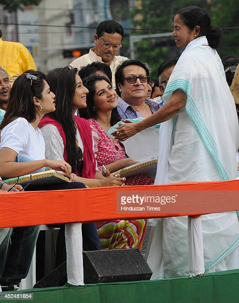 TMC party chief and West Bengal Chief Minister Mamata Banerjee with Tollywood stars during Shaheed Diwas rally organized by the TMC party at...