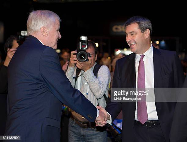 Party conference of the Christian Social Union in Munich Horst Seehofer Bavarian Prime Minister welcomes the Bavarian Minister of Finance Markus...