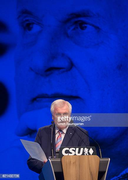 Party conference of the Christian Social Union in Munich Horst Seehofer Bavarian Prime Minister during his speech Seehofer portrait on the canvas in...