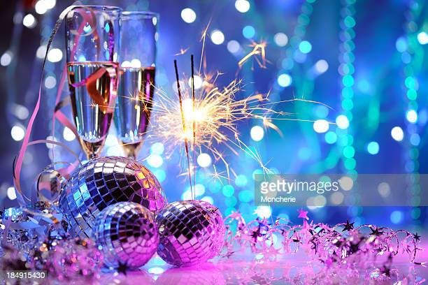 party decoration with disco balls and fire sparkler - disco ball stock photos and pictures
