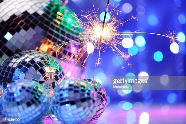 Party decoration with disco balls and fire sparkler