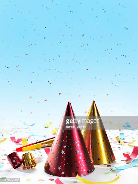 Party decorations: hats, whistles, horns, confetti on gradient blue background