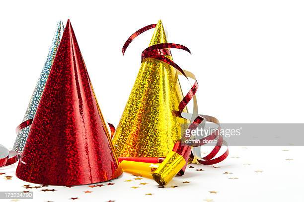 Party decorations: hats, whistles, streamers, confetti, isolated on white background