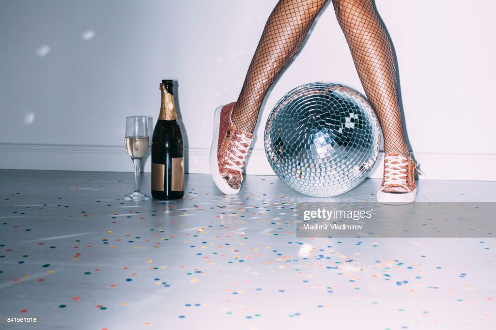 Party details of female legs and disco ball : Stock Photo
