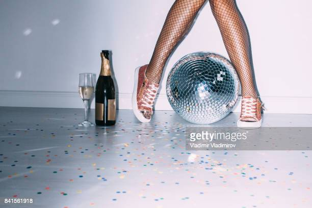 party details of female legs and disco ball - women wearing pantyhose stock photos and pictures