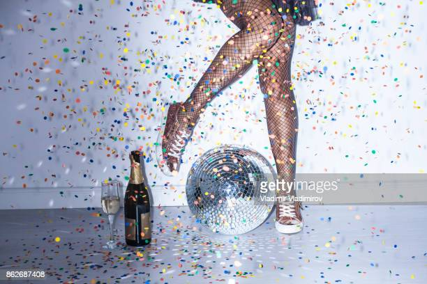 party details of female legs and disco ball - mirror ball stock pictures, royalty-free photos & images