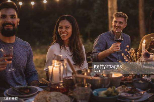 party dinner on porch - dining stock pictures, royalty-free photos & images