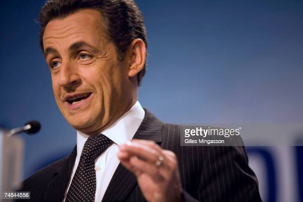 Party French presidential candidate Nicolas Sarkosy addresses supporters at a rallly during which he laid out his position on immigration and the...