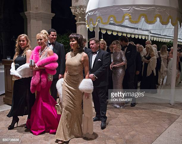 Party goers line up to enter US Presidentelect Donald Trump's New Year's Eve party December 31 2016 at MaraLago in Palm Beach Florida / AFP / DON...