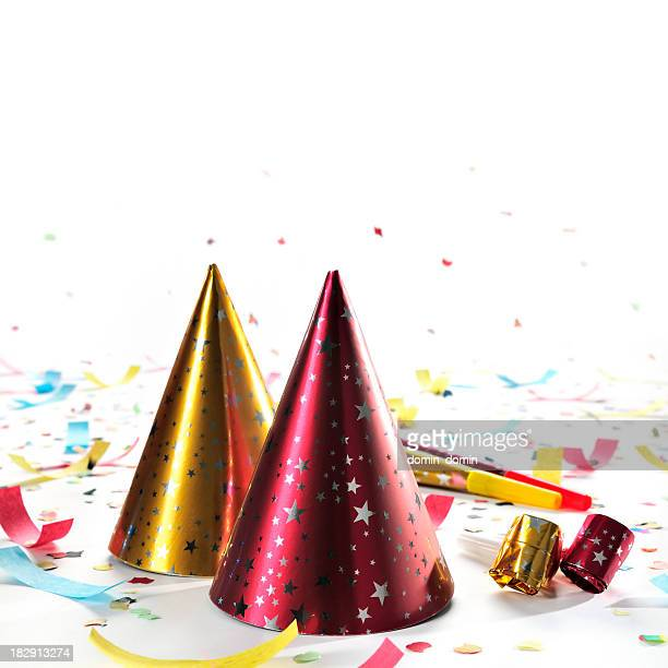 party hats, whistles, horns, confetti isolated on white, studio shot - party blower stock pictures, royalty-free photos & images