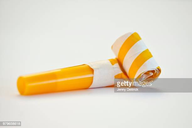 party horn blower - party blower stock pictures, royalty-free photos & images