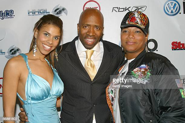 Party host Kenny Smith and wife Dawn with Queen Latifah at the Stuff Magazine Reebok NBA AllStar Weekend Party held at The Hobby Center for the...