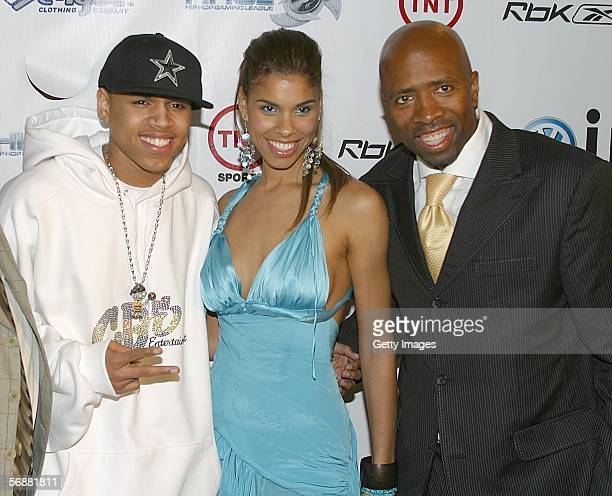 Party host Kenny Smith and wife Dawn with RB singer Chris Brown at the Stuff Magazine Reebok NBA AllStar Weekend Party held at The Hobby Center for...