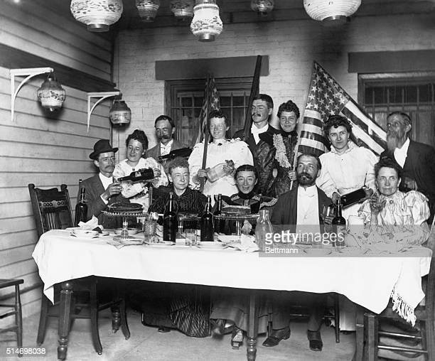 1894 A party in a middle class home Plenty of drinks in evidence The flags point to a 4th of July celebration SEE